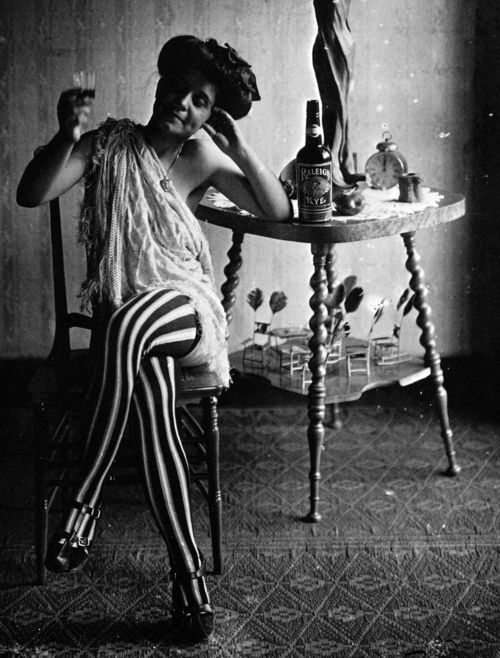 A photograph of a prostitute in striped stockings, circa 1912. Part of E. J. Bellocq's famed collection taken in Storyville, the legal red light district in turn of the century New Orleans. Miz Mary played this character in 'Pretty Baby': Style, Baby