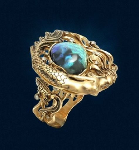 Ring 'Mermaid' performed in a dynamic, lush style with fancy plastic and scenic fluidity of forms. In the image of Mermaid - Australian opal...