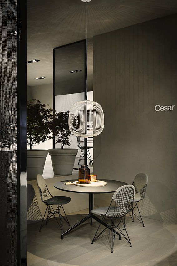 The renovated Cesar flagship store in #Milano - #Spokes lamp by #Foscarini - Photo © Andrea Ferrari