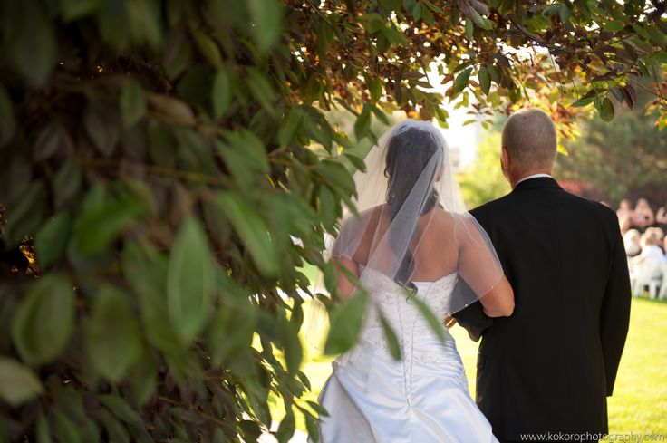 The father of the bride walks her down the aisle to the gazebo. Wedding Planning by MuseEvents.com, Chateaux at Fox Mountain