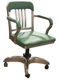 A proper office chair must swivel, tilt, roll, and have arms.