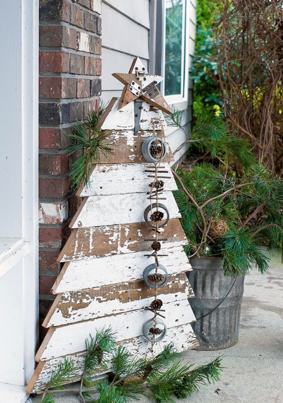 reclaimed wood Christmas tree and star in chippy white boards for a front porch