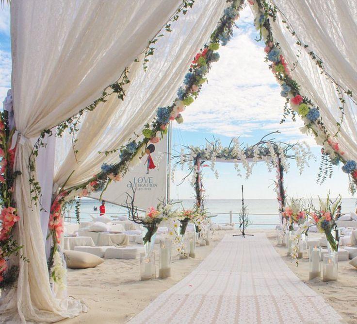 @gideonhermosa Beach Wedding tent draping white ceremony huppah chupah flowers greenery wedding planner event party styling beach sand