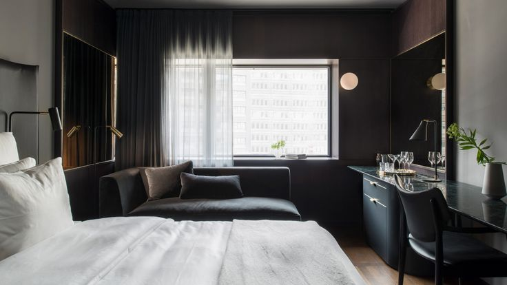 Universal Design Studio completes At Six, a hotel in a brutalist tower in Stockholm that is home to one of Europe's most significant hotel art collections