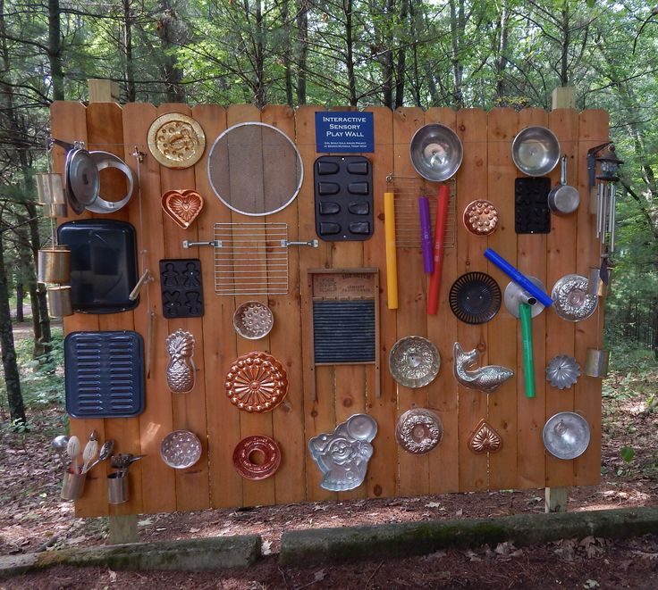 Recycled and repurposed pots, pans and music makers fill a cedar fence panel to create a musical, sensory experience for visually impaired youth.