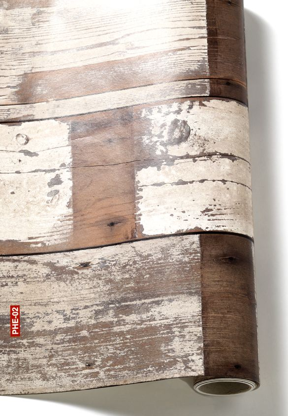 Faux wood wall paper..I have seen this before and I think there are applications where it would be great. Follows the reclaimed flooring trend...