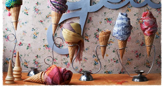 Been wondering today about different ways to display scarves....going to steal this anthropologie idea, but use cardboard for cones...Cool!