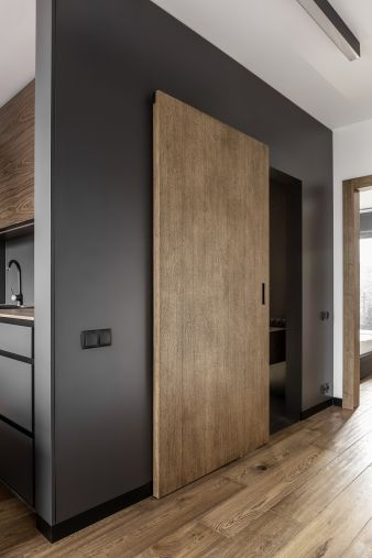 A sliding door provides access to the bathroom