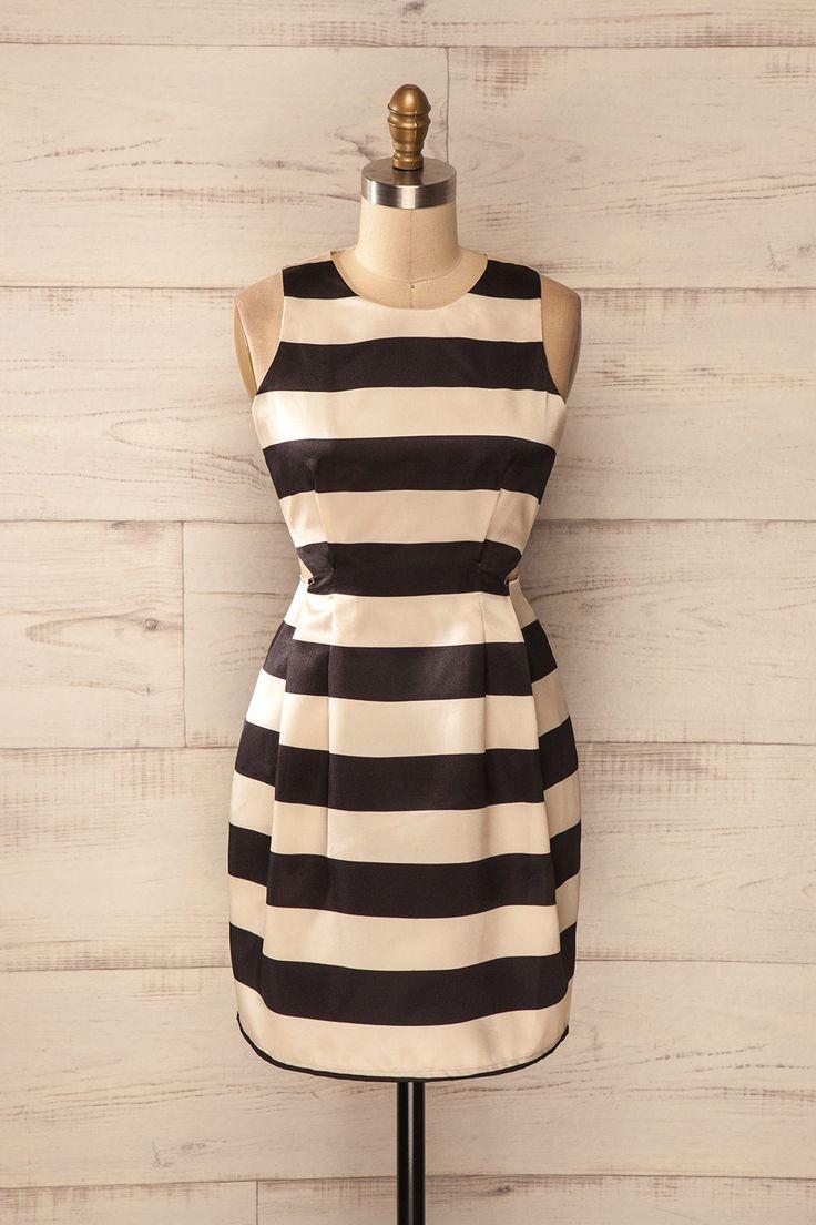 Sans aucun effort, elle était devenue la cible de tous les regards. She had effortlessly become the target of all gazes. Black and beige stripes cut-outs dress www.1861.ca
