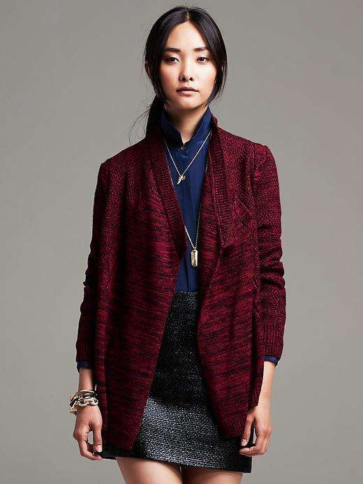 banana republic Red Cable-Knit Open Cardigan I am not a fan of pinning commercial sites but Wantering caught my eye because their sweater line looks like stuff I would so knit now.  Note how this one looks handknit and from BUGGA no less.