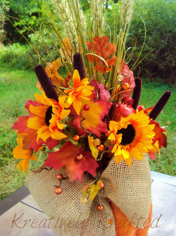 Large pumpkin autumn floral arrangement table centerpiece