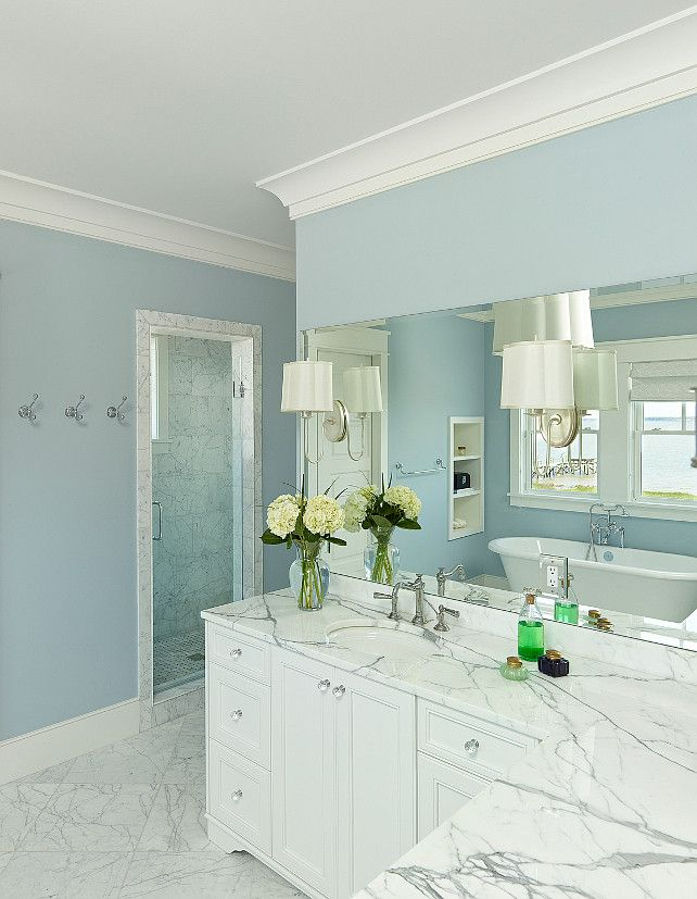 Walls are Benjamin Moore - Breath of Fresh Air 806 and I think the trim is Benjamin Moore Simply White OC-117