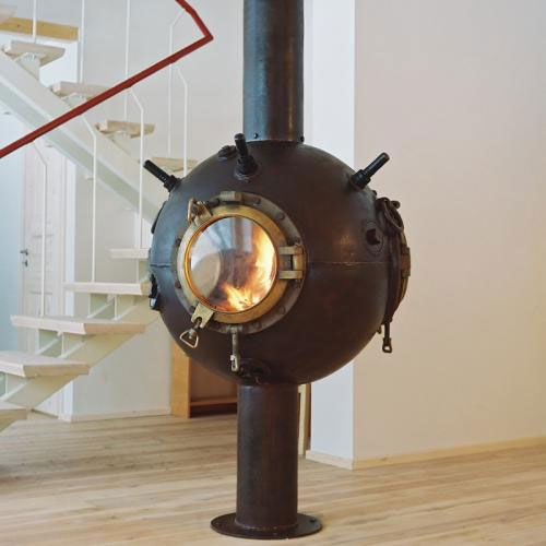 This must be my favorite upcycling solution ever: naval mine = fireplace!