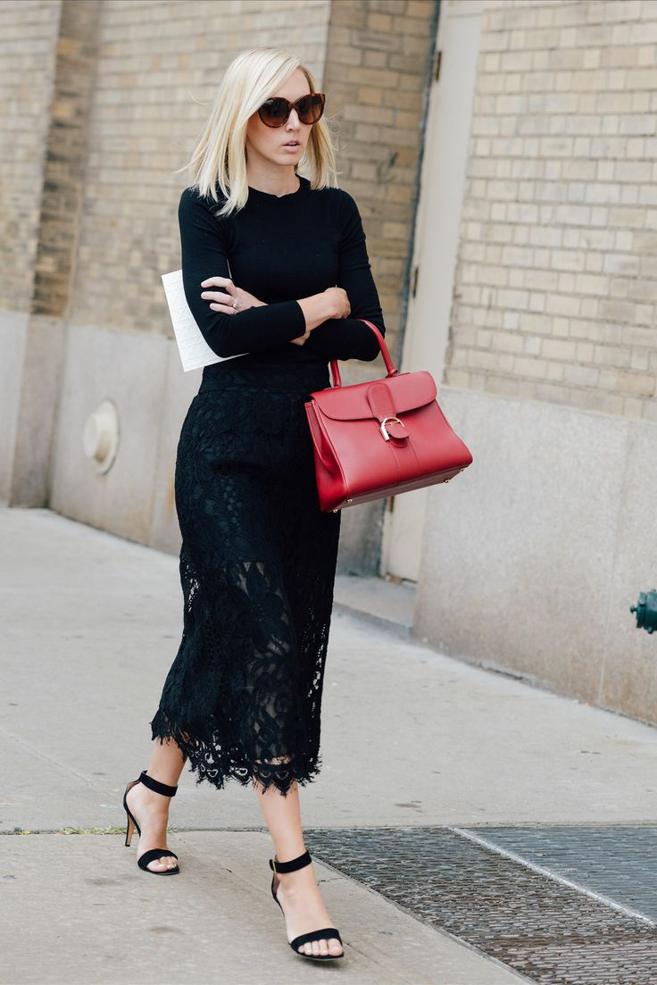 Shop this look for $105:  http://lookastic.com/women/looks/sunglasses-and-crew-neck-sweater-and-satchel-bag-and-midi-skirt-and-heeled-sandals/3682  — Dark Brown Sunglasses  — Black Crew-neck Sweater  — Red Leather Satchel Bag  — Black Lace Midi Skirt  — Black Suede Heeled Sandals