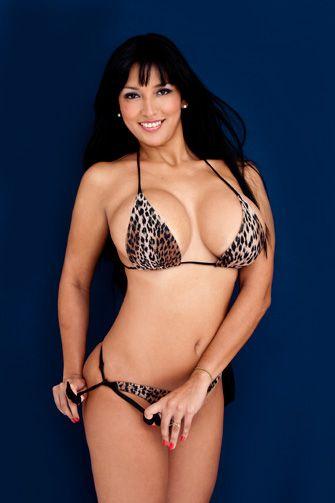 image Stunning brunette programs off her body