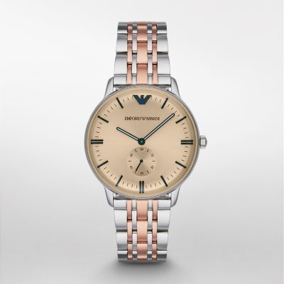 Sale  Dress Watch - Watch Station Exclusive The sleek stainless-steel and rose gold-tone bracelet of this Emporio Armani men's watch keeps the focus on the silver sunray dial with applied amber crystal. The dial is accented with navy blue stick indexes and a sixty-second subdial.