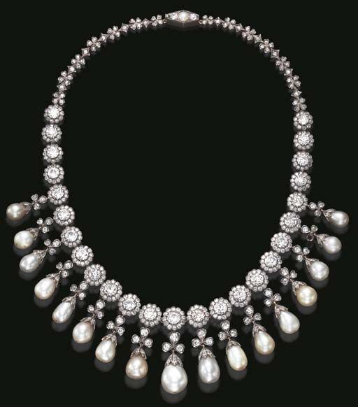AN EXQUISITE ANTIQUE PEARL AND DIAMOND NECKLACE  The front decorated with a fringe of seventeen drop-shaped graduated pearls, enhanced by an old European and single-cut diamond cap, suspended by an old mine and old European-cut diamond trefoil motif, from a series of similarly-set floret links, to the backchain of diamond quatrefoil and lozenge-shaped links, joined by a navette-shaped pearl and old European-cut diamond clasp, mounted in silver and gold, circa 1900