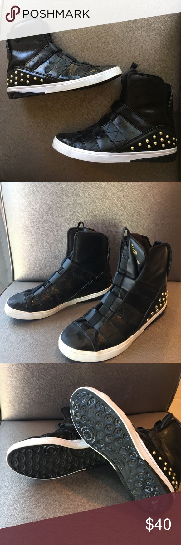ADIDAS WOMEN'S HIGH TOP BLACK STUD SNEAKERS ADIDAS WOMEN'S HIGH TOP BLACK STUD SNEAKERS. SUPER CHIC SNEAKERS WITH GOLD STUDS AROUND THE BASE OF THE HEEL . Size 7 .GREAT CONDITION & COMFORTABLE Adidas Shoes Sneakers