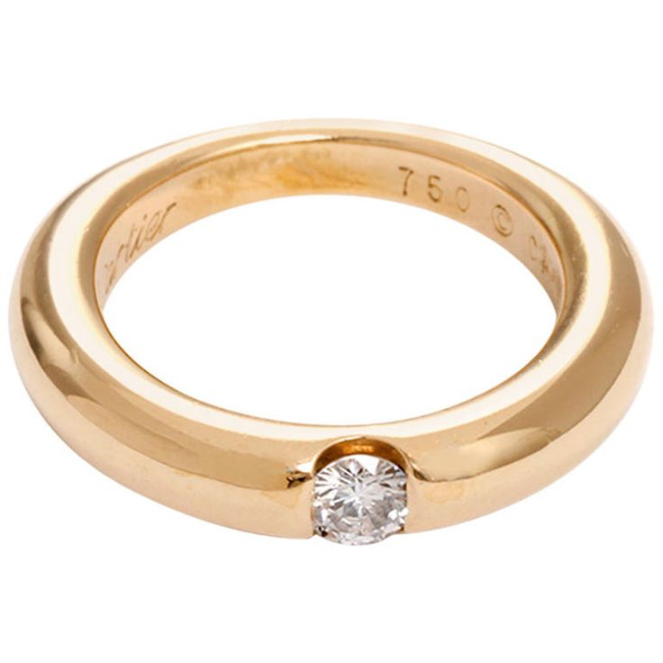 Cartier Ellipse Diamond Gold Solitaire Ring | From a unique collection of vintage solitaire rings at https://www.1stdibs.com/jewelry/rings/solitaire-rings/