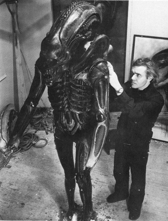 H.R. Giger working on a piece for the movie Alien. (I love the look of concentration on his face.)