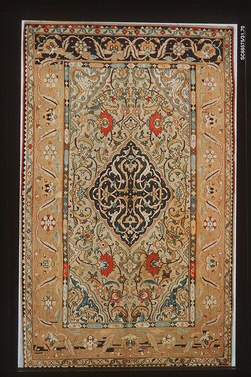 Object Name:     Carpet Date:     first half 17th century Geography:     Iran, probably Kashan Medium:     Silk, metal-wrapped thread; tapestry weave Dimensions:     H: 93 in. (236.2 cm) W: 57 in. (144.8 cm) Classification:     Textiles-Rugs