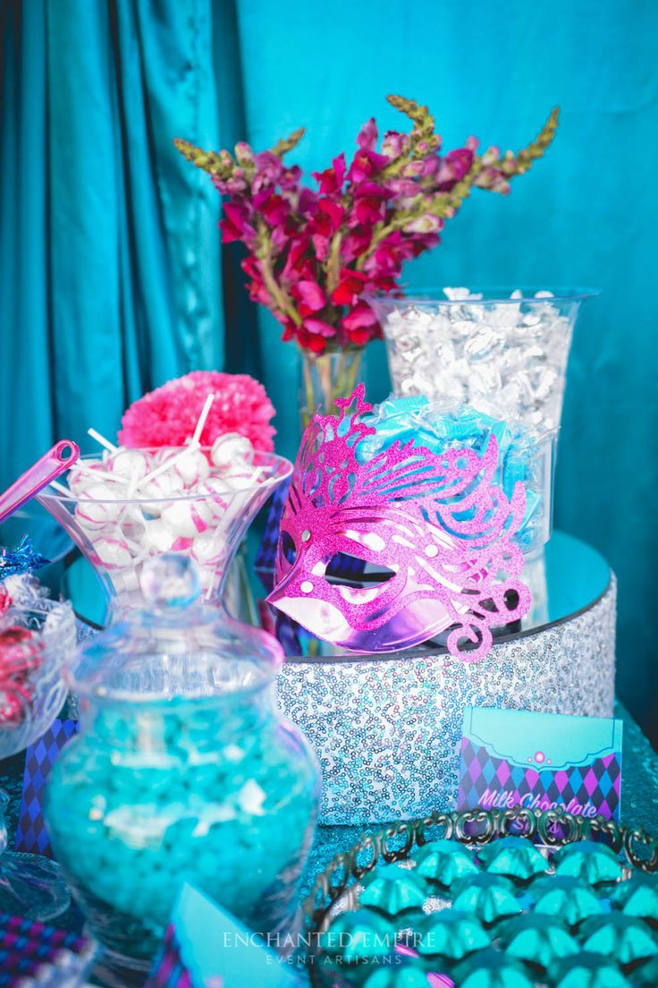 A vivid colour palette of Turquoise, Teal + Magenta was carried throughout this Masquerade Event through ornately decorated masks, custom designed Props. Bright sequin linen dressed the dry bars and dessert table, complimented by black Baroque furniture to draw out the dramatic elements. Guests were able to treated to an array of delicious treats at the candy station, which featured theme candy and customised chocolate wraps. Youtube…