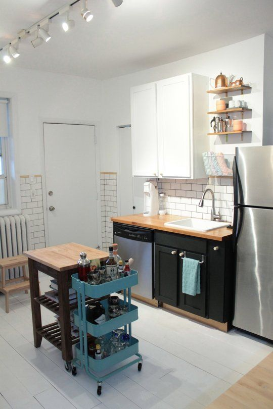 Consider kitchen and DR floors. Not nec identical. Bar cart on wheels, stored near mini-island........ Before & After: Melissa's Country-Meets-City Kitchen Makeover — The Big Reveal | The Kitchn