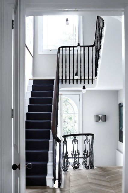 Spiral? Floating? Discover staircase design ideas on HOUSE - design, food and travel by House & Garden. A monochrome colour scheme to give definition to the architectural details.