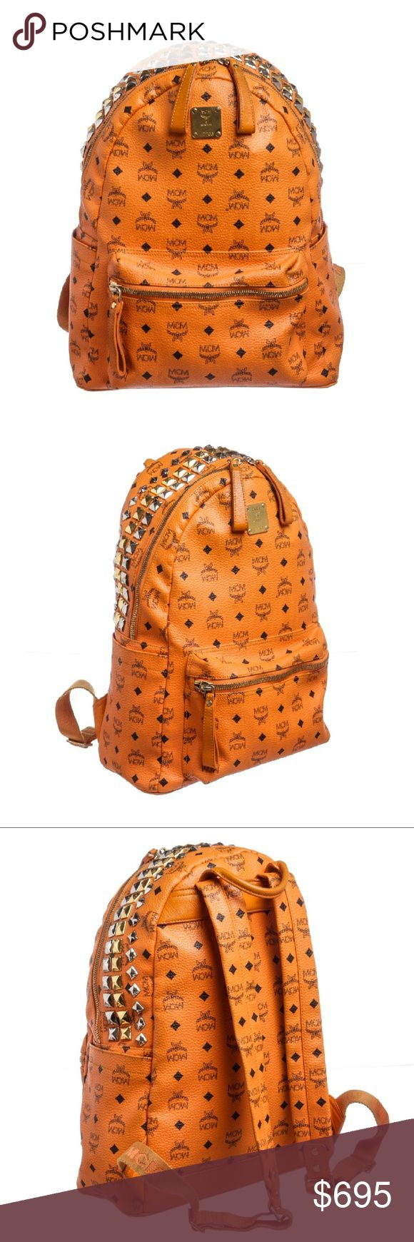 MCM Orange Visetos Coated Medium Stark Backpack Overall zipper closure top studded.  Interior is fabric lined, side zipper pocket, and two side slip pockets. Exterior zipper pocket.  Two exterior side slip pockets.  Adjustable straps. Shop AUTHENTIC MCM backpacks at MARQUE SUPPLY COMPANY.    5197MSC MCM Bags Backpacks
