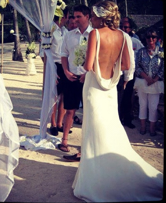 Cat wearing a backless Jane Hill Wedding Dress