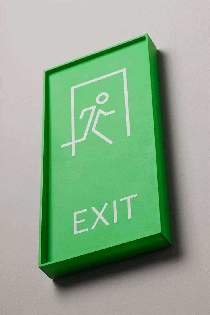 Emergency exit sign in matte painted acrylic and UV printed.