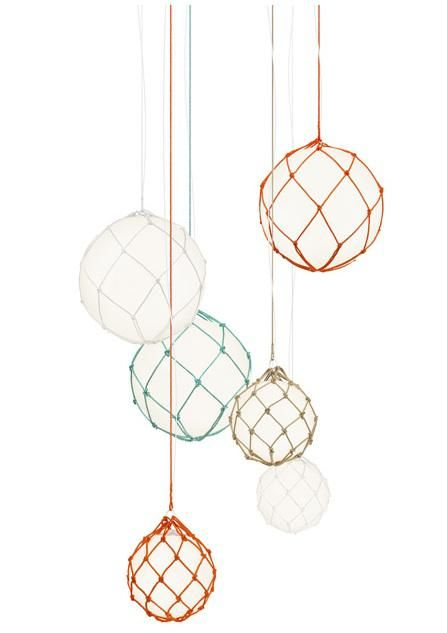 Modeled after classic glass maritime floats, the Fisherman Pendant is made of polypropylene globes suspended in hand-knitted nets made in Hönö on the west coast of Sweden. Designed by Matthias Stahlbom for Swedish lighting