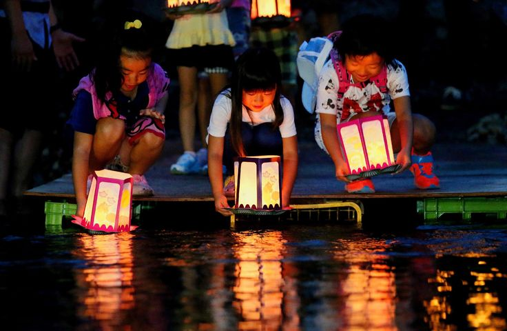 Gunma, Japan Children release lanterns in the river to offer prayers for the victims of Japan Airlines flight 123 on the eve of the 30th anniversary of the accident. Hundreds of people are expected to attend ceremonies commemorating the plane crash, which killed 520 people on board – the deadliest single-aircraft disaster in history  Photograph: Jiji Press/AFP/Getty Images