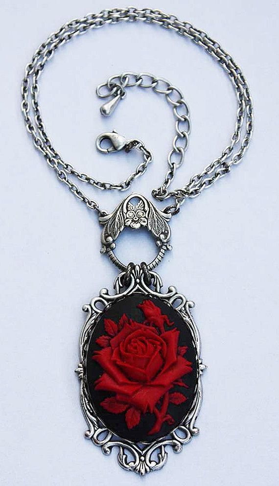 Beautiful necklace with huge (40x30 mm) rose cameo. Necklace lenght is 40 cm+5 c of adjustable chain. Adjustable ring. Made of oxidized sterling
