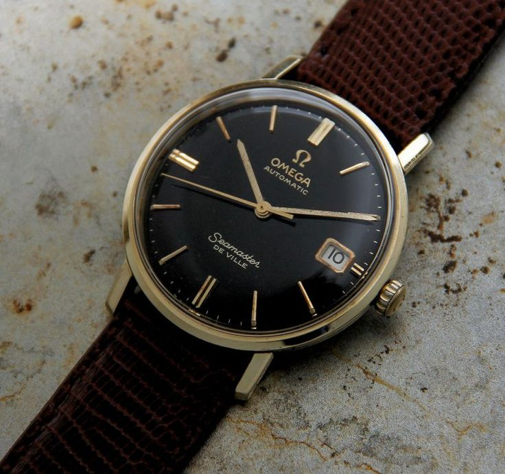 This Omega 1963 Seamaster De Ville with calendar is a beautiful piece. With the black dial enhancing the gold hands and gold baton markers, it becomes a statement of style and confidence. The case, made with a layer of real gold melted onto a base of steel, holds the original 24 jewels calibre 562 automatic movement with its 19,800 bph (5.5 beats per second) and sweeping second hand. The movement is held safe … Read More →