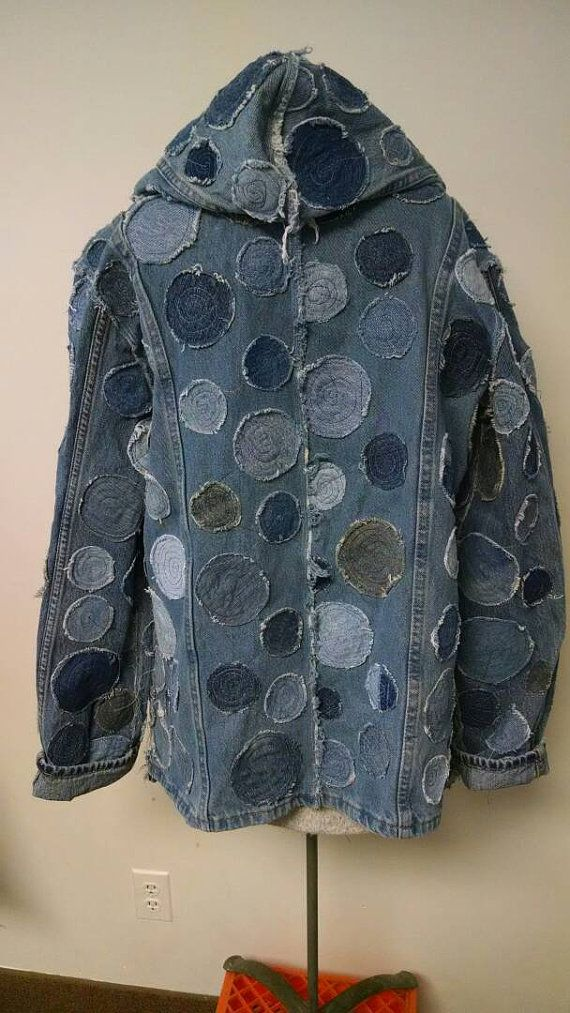 Great hooded jacket made from recycled jeans. Denim blues covered with circle applique. Nice roomy shape with one button closure at the front.
