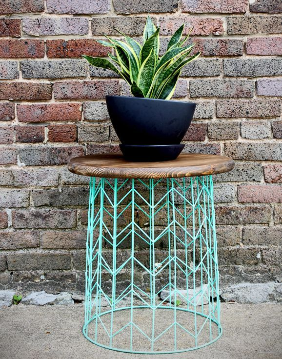 Turn a wire waste basket upside-down, add some paint and a stained wood top, and you've got a modern side table.