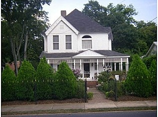 Victorian farm house in Cartersville Georgia. Idea to dress up our house - similar style, except for decoration on top porch.