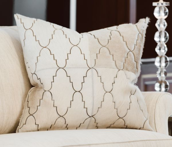 EXOTICO CUSHION - CREAM The striking yet understated Exótico features a laser design inspired by Moroccan tiles.  This beautiful repeat design creates a sophisticated aesthetic in any interior.  This cushion has been hand made by skilled artisans, each cushion is unique and one of a kind.  Cushion measures 50 x 50cm. Comes with Tonal Suedette Backing.  PET Fill included.
