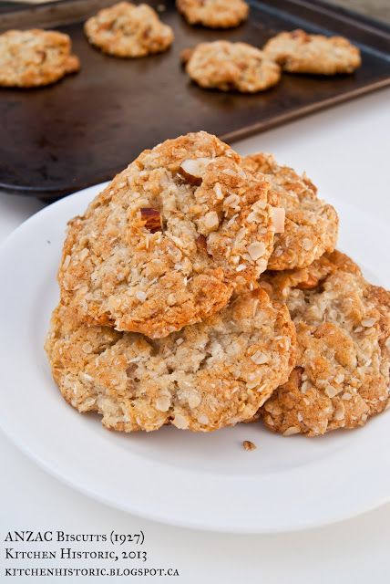 ANZAC Biscuits (1927) ★★★★★ 1/4 lb UNSALTED BUTTER 1 tablespoon GOLDEN SYRUP 2 tablespoons BOILING WATER 1/2 teaspoon BAKING SODA 3/4 cup FLOUR 1 cup SUGAR 1 cup DESICCATED COCONUT 1 cup ROLLED OATS 1/4 cup ALMONDS, chopped