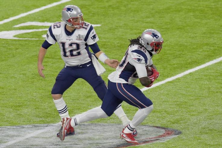 HOUSTON, TX - FEBRUARY 05:   LeGarrette Blount #29 of the New England Patriots take the handoff from Tom Brady #12 against the Atlanta Falcons during Super Bowl 51 at NRG Stadium on February 5, 2017 in Houston, Texas. The Patriots defeat the Atlanta Falco