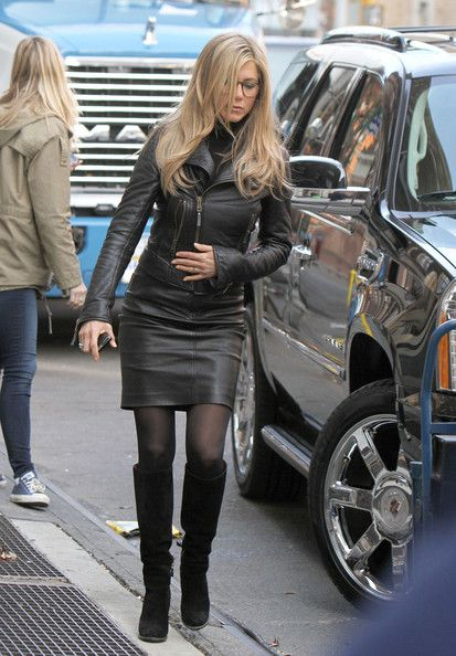 "Jennifer Aniston Knee High Boots - Jennifer Aniston filmed scenes for her new film ""Wanderlust"" in black suede knee high boots. She paired the slouchy boots with black tights, and a leather jacket and skirt."