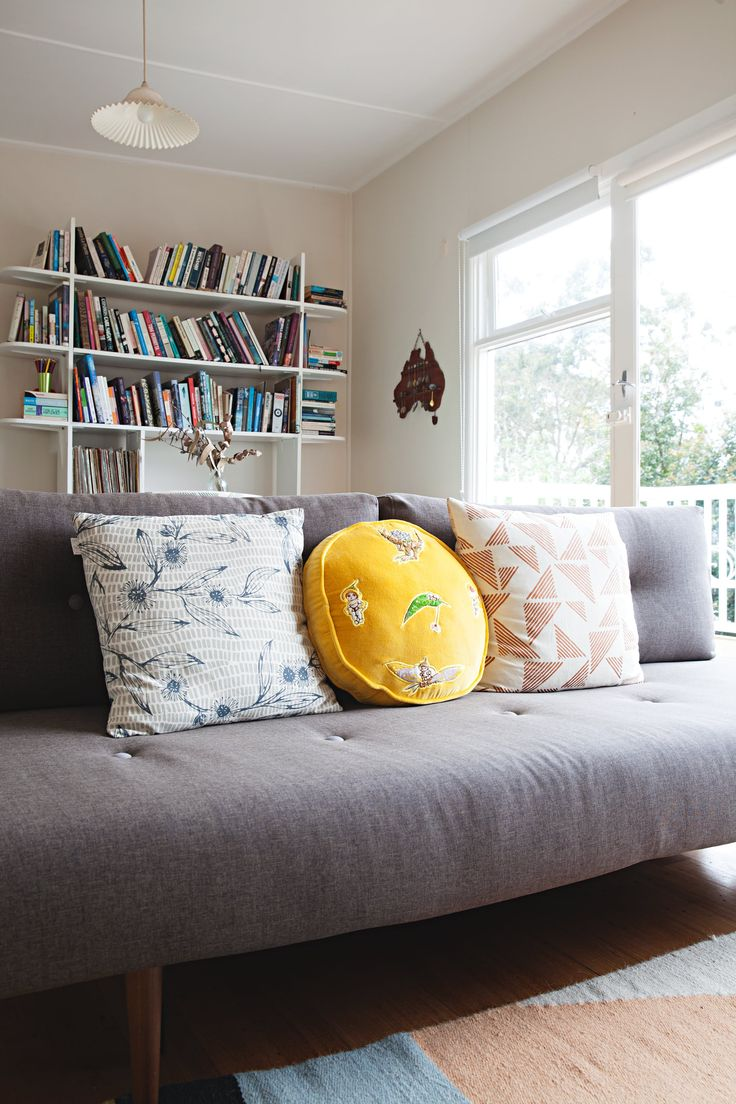"""Cute new yellow """"Gumnut Babies"""" cushion from Kip and Co x May Gibbs — a well-known Australian children's book author and illustrator. Other cushions are from Ink and Spindle."""