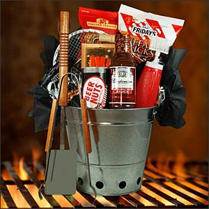For the Grooms-men. This arrangement is made in a reusable grill perfect for tailgate parties, the beach, and small outings. Utensils include a spatula, BBQ tongs, and squeeze bottle with basting brush. Add Budweiser barbecue sauce, spicy buffalo sticks, beer nuts, dipping pretzels, nacho cheese spread, popcorn, and you've got a party to go. Or...our 5 would be happy with a case of beer. ha
