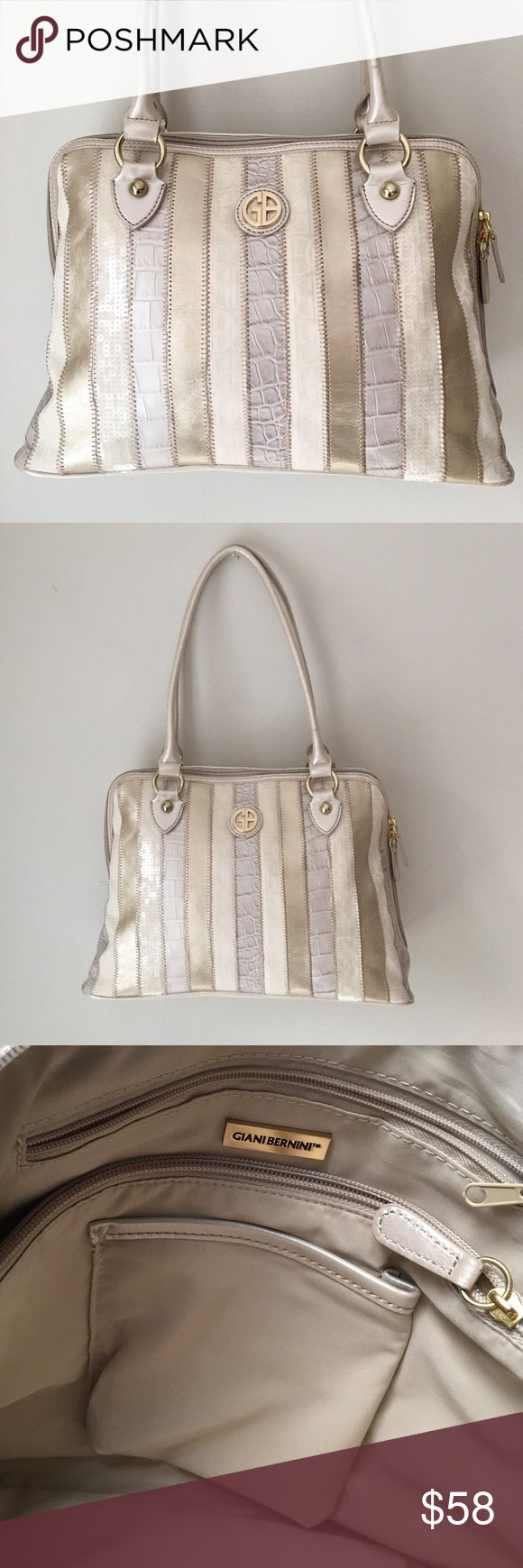 """Giani Bernini Ivory/Gold Stripe Shoulder Bag Gorgeous ivory/pale gold stripe shoulder bag by Gianni Bernini. Stripes vary - pale gold /ivory beads that look like sequin/logo fabric/snakeskin pattern. Depth: 5"""" width: 14"""" length: 9 3/4"""" Handles: all the way around – 21 1/2"""" Handle drop from the center: approx 9"""" Exterior zipper pocket on one side with the Giani Bernini goldtone logo on the front. Call hardware is gold tone. Interior has one center zip pocket and one side zip pocket. Can you…"""