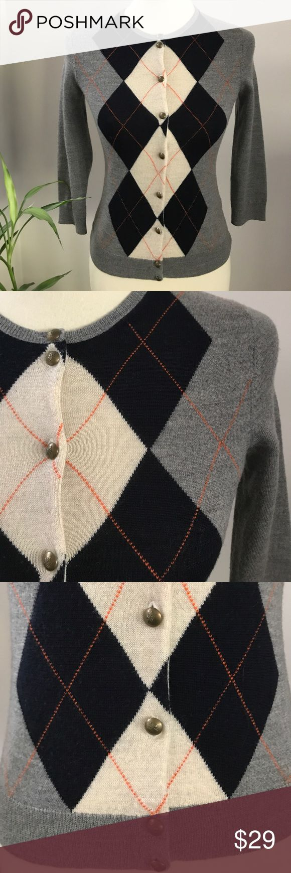 J. Crew Wool Button Down Argyle Sweater An easy wear everywhere cardigan made from lightweight 100% Merino Wool Argyle with a sightly shorter fit. Signature diamond pattern with 3/4 sleeves. Small round gold metal button down closure. Ribbed trim neckline.  Black, grey, cream with orange ticker stitch accent. In excellent gently used condition. Dry Clean J. Crew Sweaters Cardigans