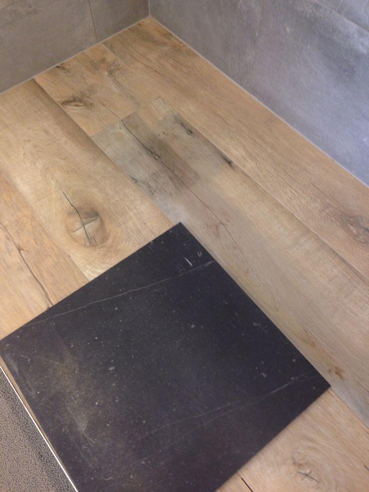 Vloerkeuze: zithoek in keramische parkettegel. Eetkamer en keuken in gezoete natuursteen