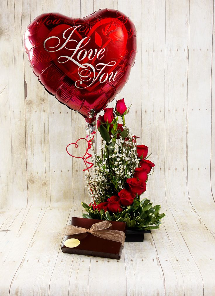Go all out with a balloon, roses and a box of chocolates