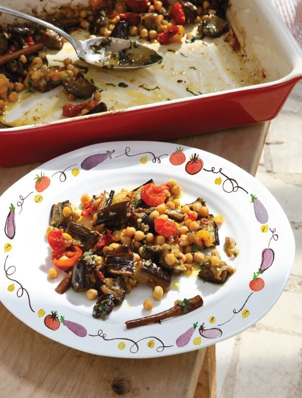 The aubergines and tomatoes in this dish almost melt together in the oven, forming a savoury, chunky semi-sauce for the nutty little chickpeas. Like many dishes of its kind (ratatouille, for one), this is best served warm or at room temperature, rather than piping hot or fridge cold. A bowlful of this, just as it is, makes a delicious lunch or light supper. Add rice or warm pitta breads and a green salad and you have quite a meal.