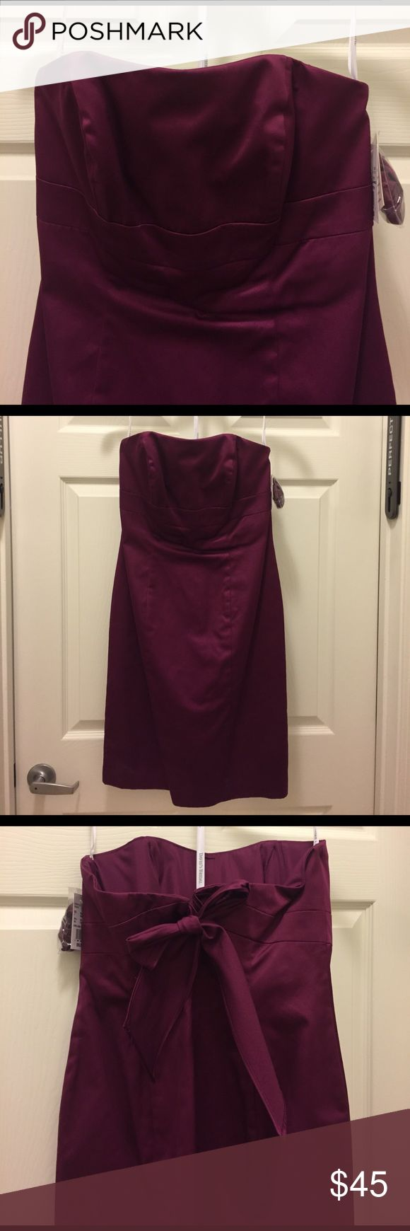 NWT David's Bridal Size 4 dress David's Bridal Size 4 dress. NWT. The color is Sangria. Shell is 100% Cotton. Lining is 100% Polyester. Hits just above the knee (I'm 5ft4) David's Bridal Dresses Wedding